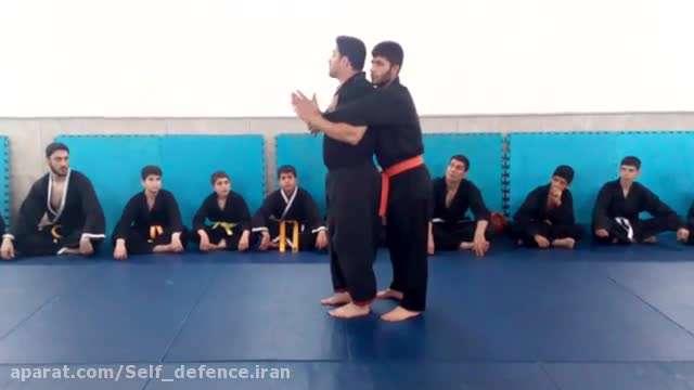 تکنیک دفاع شخصی رهایی از روی دست از سمت پشت