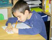 kid doing his homwork assigment