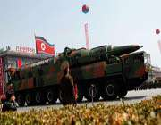a north korean vehicle carrying a new missile passes by during a mass military parade in pyongyang