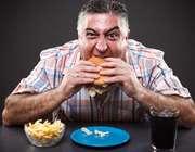 پرخوری و خوردن غذاهای فست فود